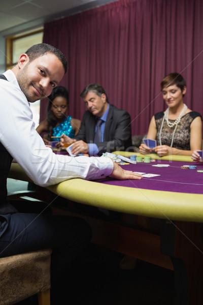 Smiling dealer at poker game in casino Stock photo © wavebreak_media