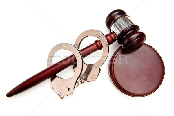 Gavel and handcuffs against white background Stock photo © wavebreak_media