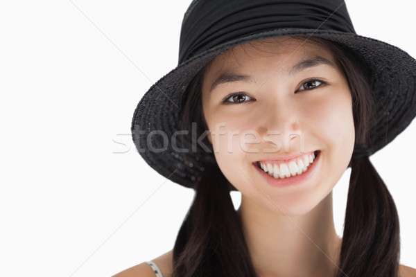Smiling woman in pigtails wearing hat Stock photo © wavebreak_media