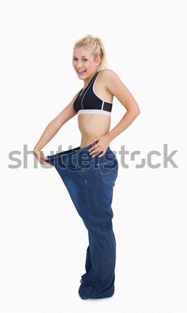 Jovem saudável mulher velho calças Foto stock © wavebreak_media