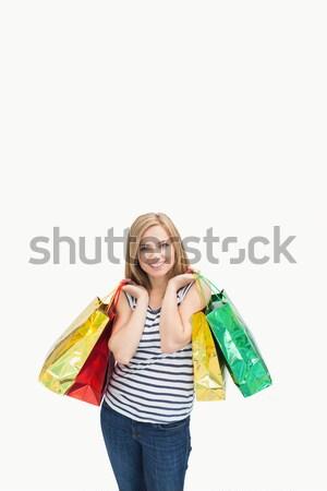 Portré fiatal nő bevásárlótáskák fehér divat szépség Stock fotó © wavebreak_media