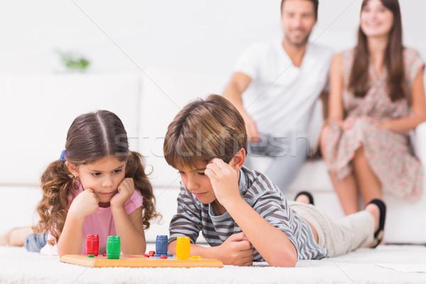 Irmãos jogar piso pais sessão Foto stock © wavebreak_media
