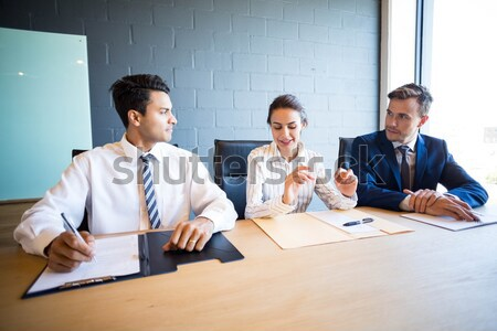 Business people taking notes at desk Stock photo © wavebreak_media