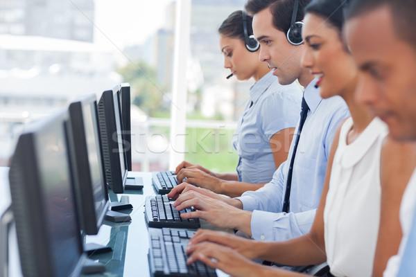 рабочих компьютеры гарнитура женщину Сток-фото © wavebreak_media
