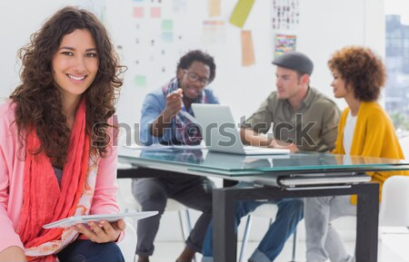 Sorridente editor comprimido equipe trabalhando atrás Foto stock © wavebreak_media
