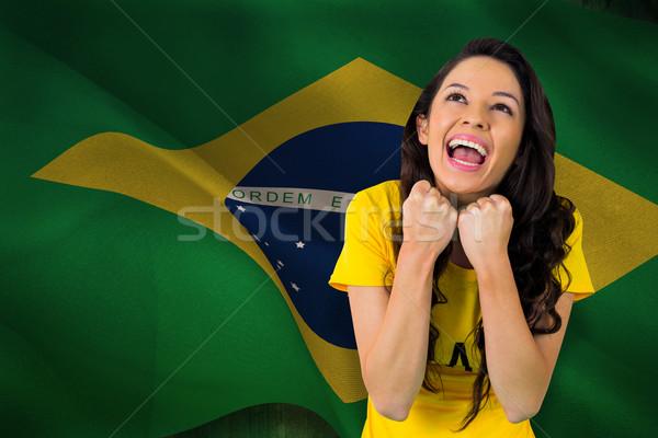Excitado fútbol ventilador brasil camiseta digitalmente Foto stock © wavebreak_media