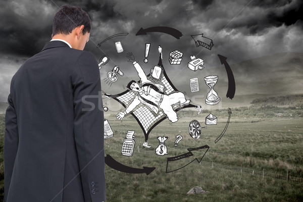 Composite image of business graphic on stormy background Stock photo © wavebreak_media