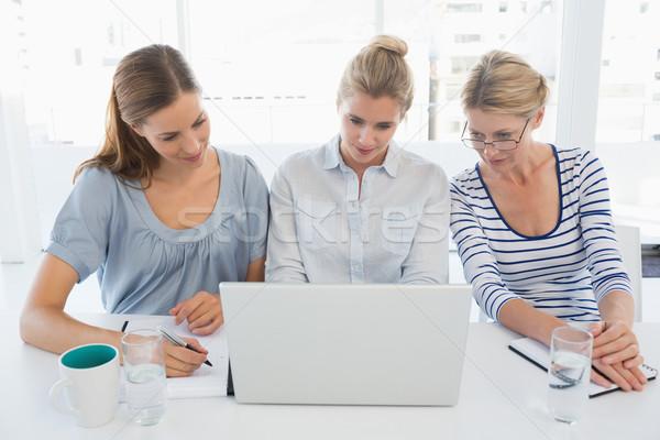Konsantre gençler çalışma ofis üç parlak Stok fotoğraf © wavebreak_media