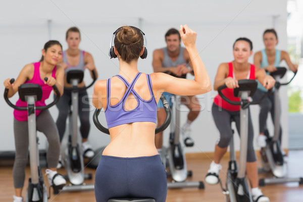 Trainer and fitness class at spinning class Stock photo © wavebreak_media