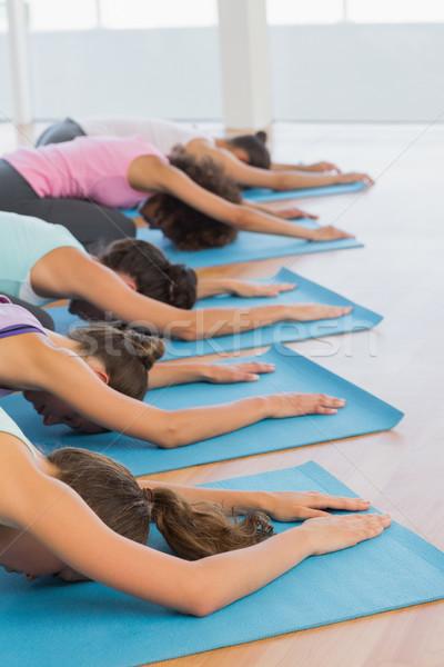 Vrouwen meditatie pose fitness studio zijaanzicht Stockfoto © wavebreak_media
