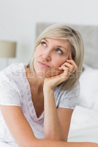 Tensed mature woman sitting in bed Stock photo © wavebreak_media