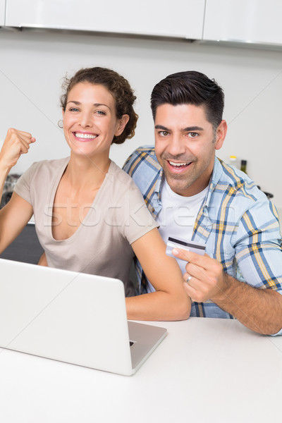 Excited couple using laptop together to shop online Stock photo © wavebreak_media