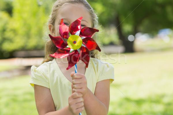 Cute girl holding pinwheel at park Stock photo © wavebreak_media