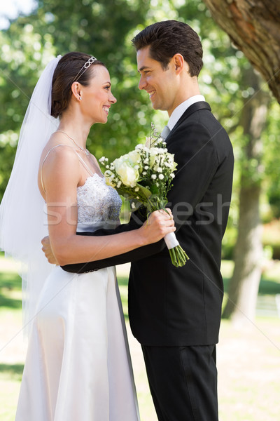 Newly wed couple looking at each other in garden Stock photo © wavebreak_media