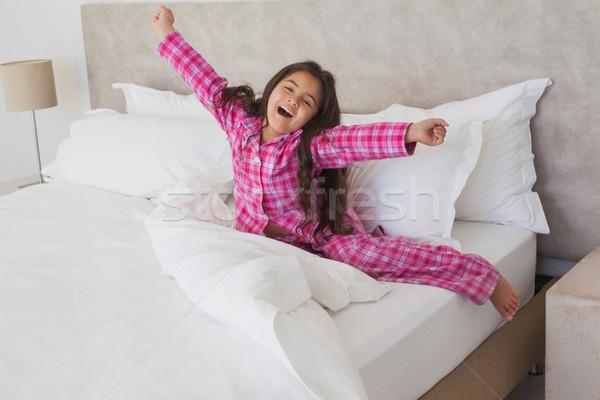 Lány ásít nyújtás karok ágy portré Stock fotó © wavebreak_media