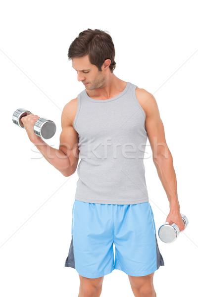 Fitt fiatalember testmozgás súlyzók fehér férfi Stock fotó © wavebreak_media