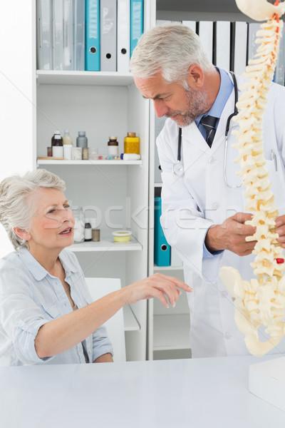 Male doctor explaining the spine to senior patient Stock photo © wavebreak_media