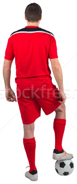 Football player wearing red gear standing with ball Stock photo © wavebreak_media