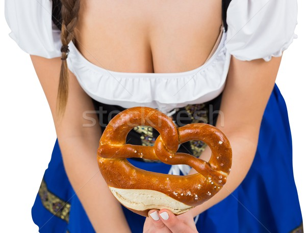 Oktoberfest girl bending and showing pretzel Stock photo © wavebreak_media