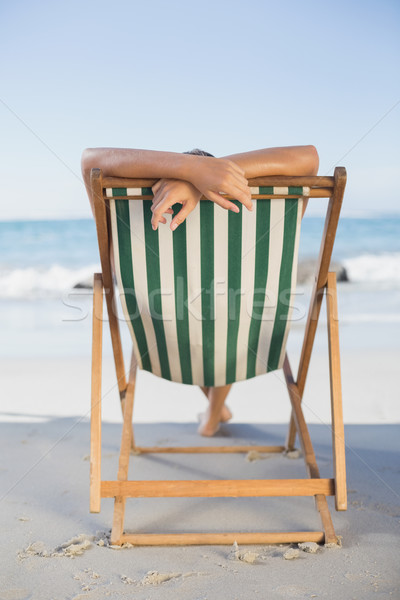 Kobieta relaks pokład krzesło plaży Zdjęcia stock © wavebreak_media