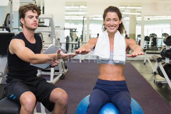 Edző néz ügyfél ül testmozgás labda Stock fotó © wavebreak_media