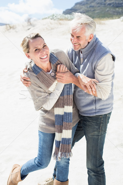Attractive couple messing about on the beach Stock photo © wavebreak_media