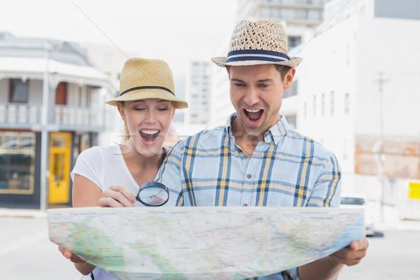 молодые туристических пару Consulting карта увеличительное стекло Сток-фото © wavebreak_media
