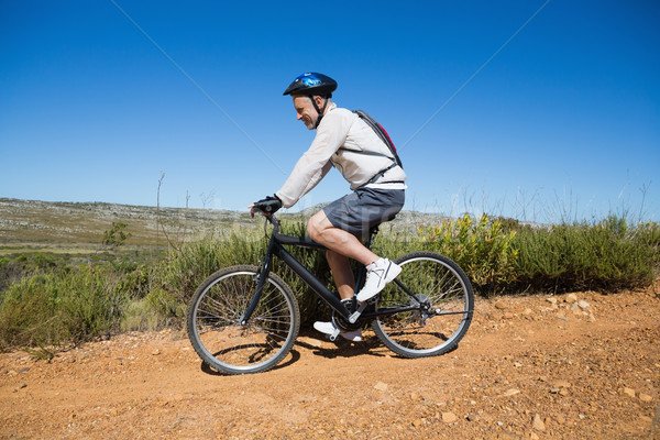 Fit cyclist riding on country terrain Stock photo © wavebreak_media