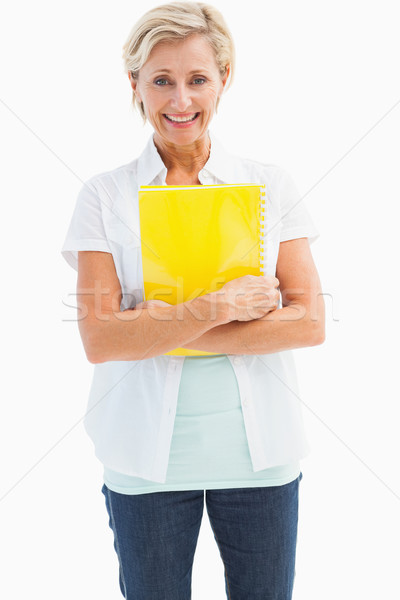 Happy mature student holding notebook Stock photo © wavebreak_media
