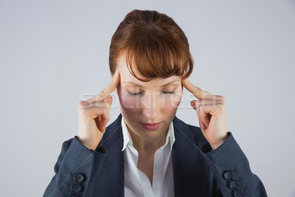 Stressed businesswoman getting a headache Stock photo © wavebreak_media