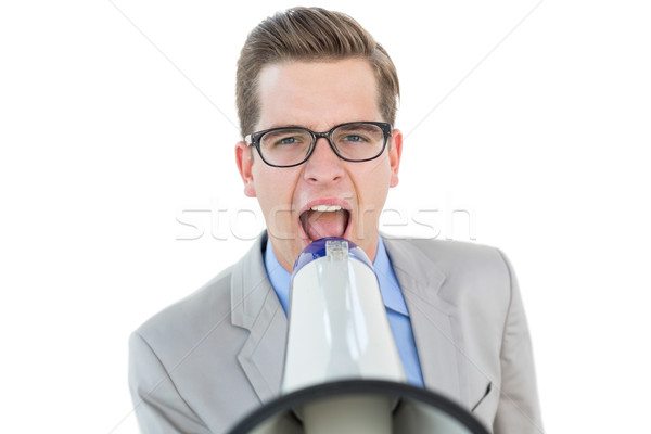 Nerdy businessman shouting through megaphone Stock photo © wavebreak_media