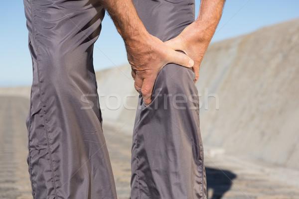 Attivo senior uomo toccare ginocchio Foto d'archivio © wavebreak_media
