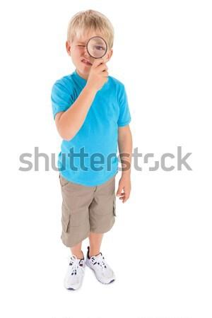 Cute peu garçon regarder loupe blanche Photo stock © wavebreak_media