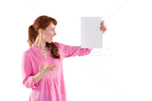 Nő megrémült néz papír fehér női Stock fotó © wavebreak_media