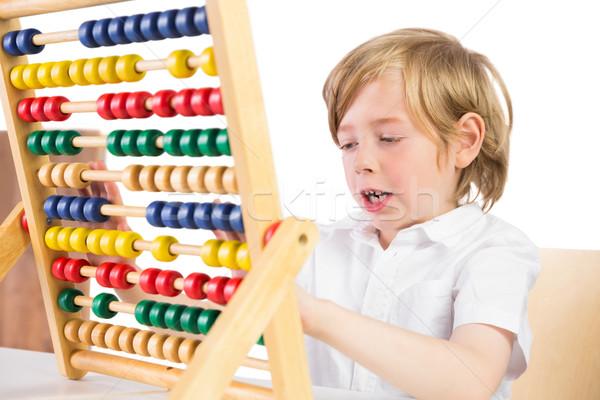 Student doing maths on abacus Stock photo © wavebreak_media
