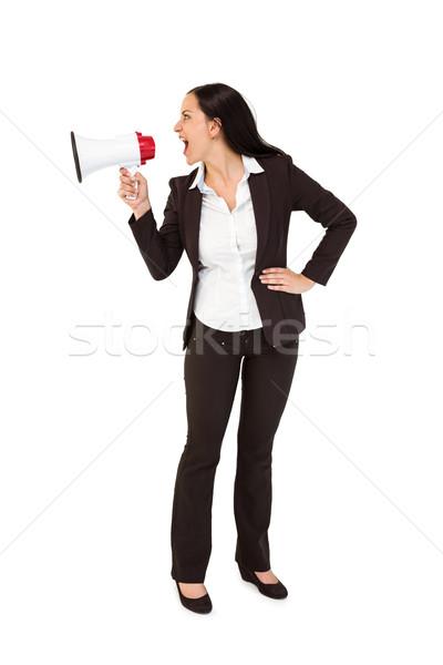 Pretty businesswoman shouting with megaphone Stock photo © wavebreak_media