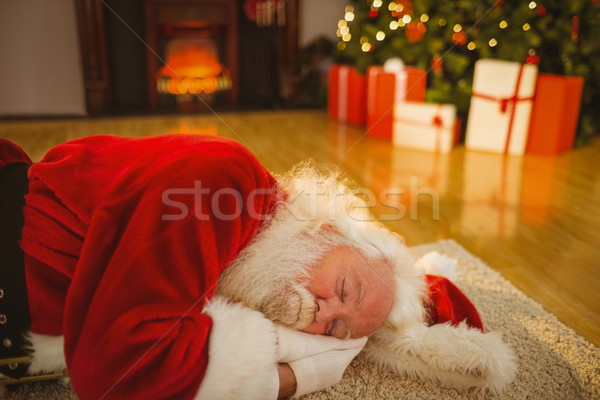 Apa karácsony alszik szőnyeg otthon nappali Stock fotó © wavebreak_media