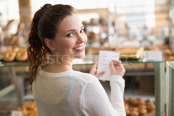 Donna shopping elenco panetteria business mani Foto d'archivio © wavebreak_media