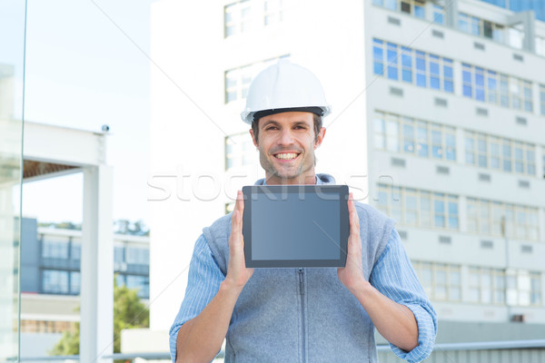 Handsome male architect showing digital tablet Stock photo © wavebreak_media