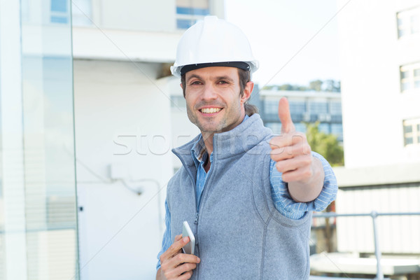 Handsome male architect gesturing thumbs up Stock photo © wavebreak_media