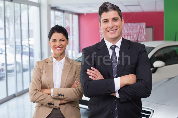 Smiling colleagues standing with arms crossed Stock photo © wavebreak_media