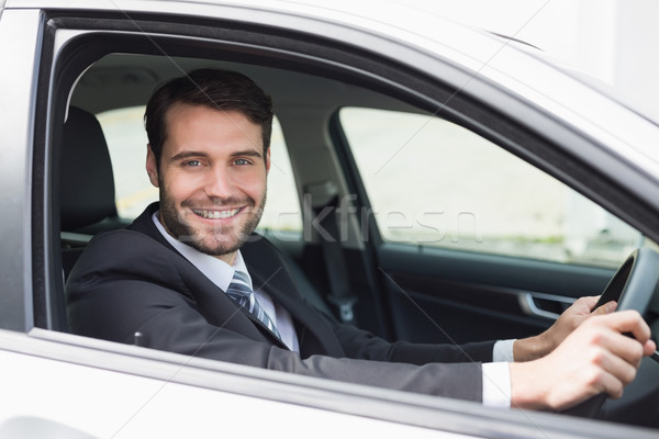 Businessman sitting in drivers seat Stock photo © wavebreak_media