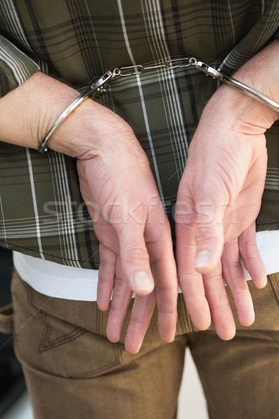 Man in handcuffs standing by his car Stock photo © wavebreak_media