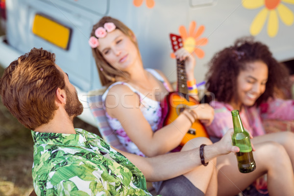 Happy hipsters relaxing on campsite Stock photo © wavebreak_media
