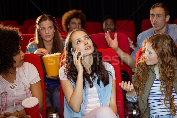 Annoying woman on the phone during movie Stock photo © wavebreak_media