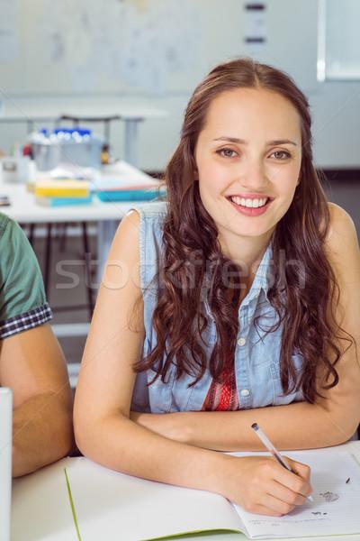 étudiant prendre des notes classe collège femme école Photo stock © wavebreak_media