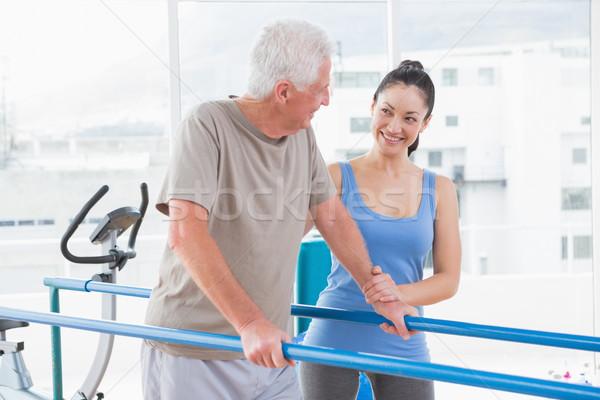 Senior man walking with trainer  Stock photo © wavebreak_media