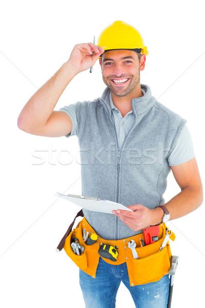 Portrait of smiling manual worker holding clipboard Stock photo © wavebreak_media