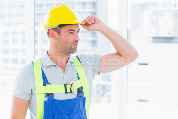 Manual worker wearing yellow hard hat Stock photo © wavebreak_media