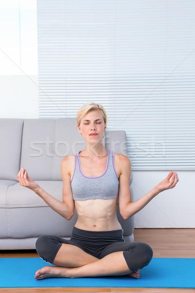 Uygun sarışın kadın meditasyon egzersiz kadın ev Stok fotoğraf © wavebreak_media